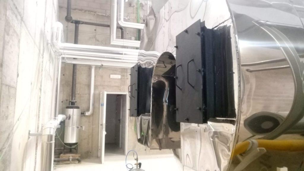 Parte trasera de la caldera y sistema de enfriamiento de purgas | Puesta en marcha de calderas industriales | Soluciones de Combustion.
